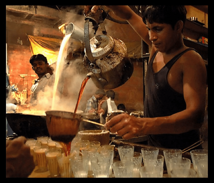 Photo courtesy of BBC news – Indian chai wallahs brewing traditional chai with cow's milk and lots of sugar.