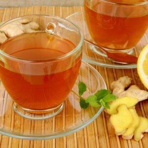 herbal chai teas on wooden mat with lemon