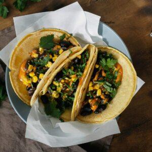 Vegetarian tacos corn tortillas black beans corn pepper spicy sa